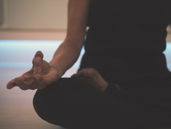 A woman sitting cross legged
