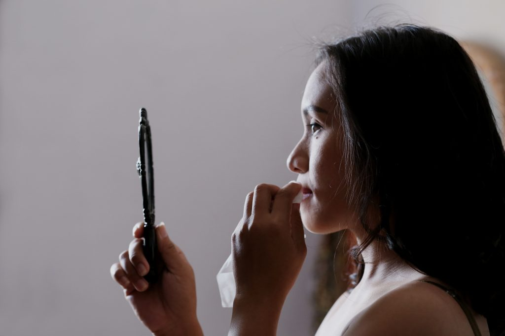 A women looking into a mirror