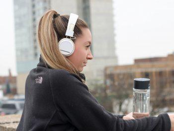 women listening to headphones