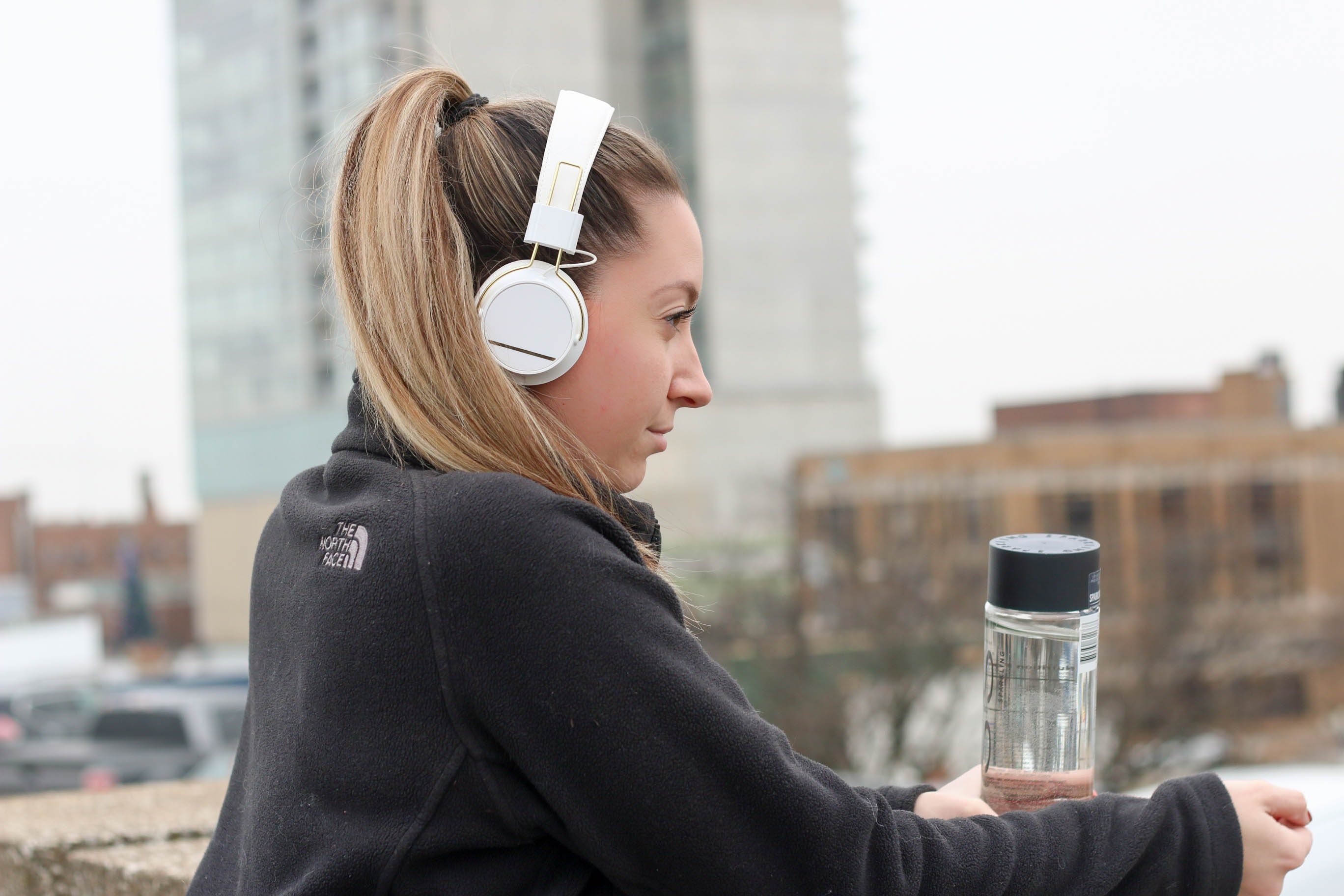 women listening with headphones