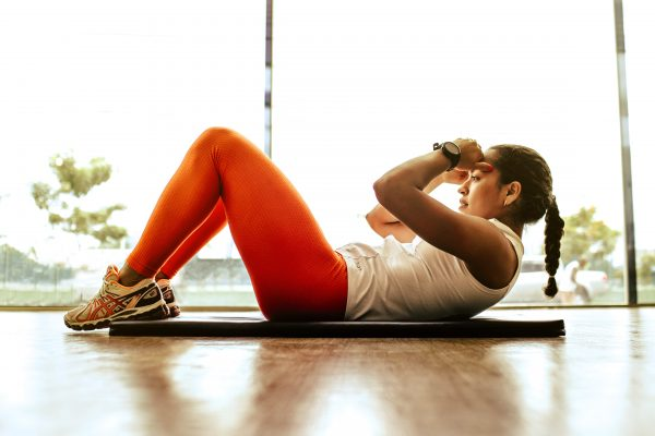 A woman doing a sit up