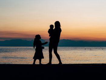 A woman and children on a beach